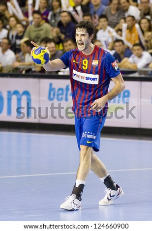 BARCELONA - MARCH 25: Raul Entrerrios in action during EHF Champions League match between FC Barcelona and Montpellier, final score 36-20, on March 25, 2012, in Palau Blaugrana, Barcelona, Spain.
