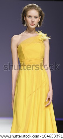 BARCELONA - MAY 11: A model walks on the Ana Torres catwalk during the Barcelona Bridal Week runway on May 11, 2012 in Barcelona, Spain.