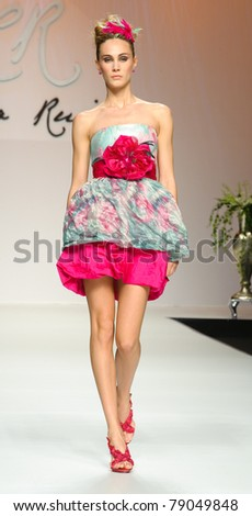 BARCELONA - MAY 13: A model walks on the Carla Ruiz catwalk during the Barcelona Bridal Week runway on May 13, 2011 in Barcelona, Spain.