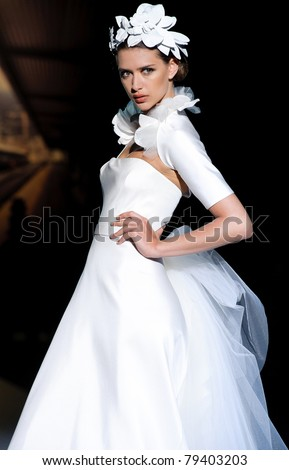 BARCELONA - MAY 11: A model walks on the Jesus Peiro catwalk during the Barcelona Bridal Week runway on May 11, 2011 in Barcelona.