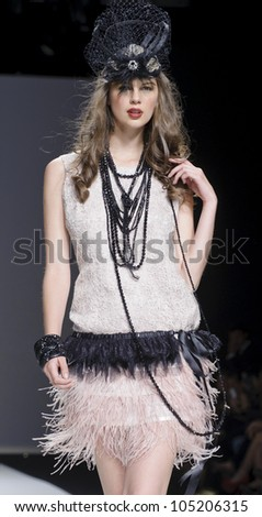 BARCELONA - MAY 10: A model walks on the Matilde Cano catwalk during the Barcelona Bridal Week runway on May 10, 2012 in Barcelona, Spain.