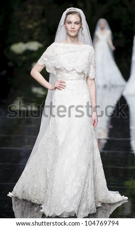BARCELONA - MAY 11: A model walks on the Pronovias catwalk during the Barcelona Bridal Week runway on May 11, 2012 in Barcelona, Spain.