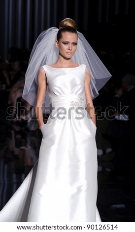 BARCELONA - MAY 13: A model walks on the Pronovias catwalk during the Barcelona Bridal Week runway on May 13, 2011 in Barcelona, Spain.