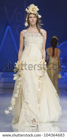 BARCELONA - MAY 09: A model walks on the Yolan Cris catwalk during the Barcelona Bridal Week runway on May 09, 2012 in Barcelona, Spain.