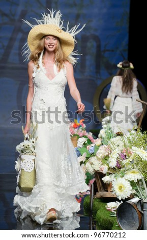 BARCELONA - MAY 11: A model walks on the Yolan Cris catwalk during the Barcelona Bridal Week runway on May 11, 2011 in Barcelona, Spain.