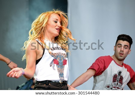 BARCELONA - MAY 23: A woman dances a choreography at the Primavera Pop Festival of Badalona on May 18, 2014 in Barcelona, Spain.