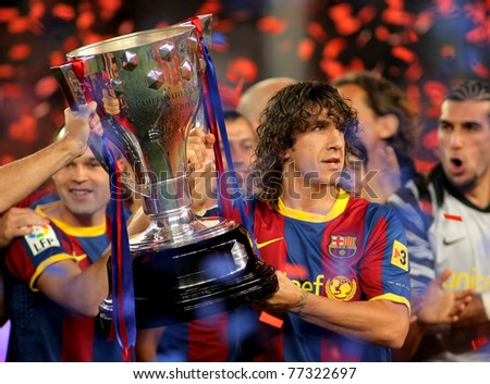 stock-photo-barcelona-may-carles-puyol-of-fc-barcelona-holds-the-la-liga-trophy-after-the-match-between-77322697.jpg