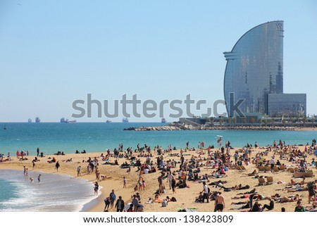 BARCELONA MAY 3 city beach 400 meters long it one of 10 best urban beaches of the world Tourists rest along Barceloneta beach May 03 2013 in Barcelona Spain