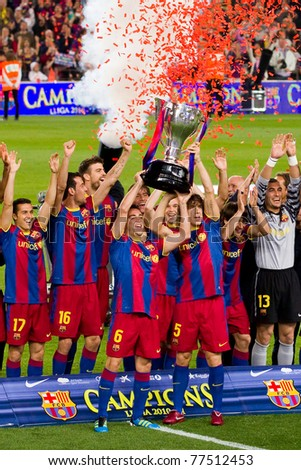 BARCELONA - MAY 15: FC Barcelona players receive the cup and celebrate the Spanish League Championship victory in Camp Nou stadium, on May 15, 2011 in Barcelona, Spain.
