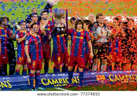 BARCELONA - MAY 15: FC Barcelona players receive the cup and celebrating the Spanish League Championship victory in Camp Nou stadium, on May 15, 2011 in Barcelona, Spain.