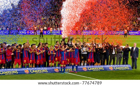 BARCELONA - MAY 15: FC Barcelona players receiving the cup and celebrating the Spanish League Championship victory in Camp Nou stadium, on May 15, 2011 in Barcelona, Spain.