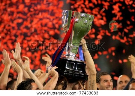 BARCELONA - MAY 15: FC Barcelona's players hold up La Liga trophy after the match between Barcelona and Deportivo La Coruna at Camp Nou Stadium on May 15, 2011 in Barcelona, Spain - stock photo