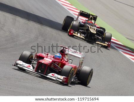 BARCELONA - MAY 13: Fernando Alonso of Ferrari F1 team racing at the race of Formula One Spanish Grand Prix at Catalunya circuit, on May 13, 2012 in Barcelona, Spain. The winner was Pastor Maldonado.