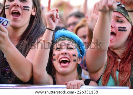 BARCELONA - MAY 23: Girls from the audience in front of the stage, cheering on their idols at the Primavera Pop Festival of Badalona on May 18, 2014 in Barcelona, Spain. #226331158