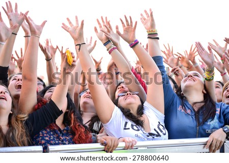 BARCELONA - MAY 23: Girls from the audience in front of the stage, cheering on their idols at the Primavera Pop Festival of Badalona on May 18, 2014 in Barcelona, Spain.