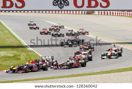 BARCELONA - MAY 13: Some F1 cars racing at the Formula One Spanish Grand Prix at Catalunya circuit, on May 13, 2012 in Barcelona, Spain. The winner was Pastor Maldonado.