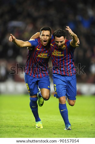 BARCELONA - NOV, 29: Alexis Sanchez (L) and Xavi Hernandez (R) of FC Barcelona celebrate goal during the match against Rayo Vallecano at the Nou Camp Stadium on November 29, 2011 in Barcelona, Spain