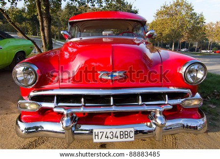 BARCELONA - NOVEMBER 12: A red Chevrolet Bel Air 1954 at a classic car show during Monster Jam Party, on November 12, 2011, in Olympic Stadium, Barcelona, Spain.