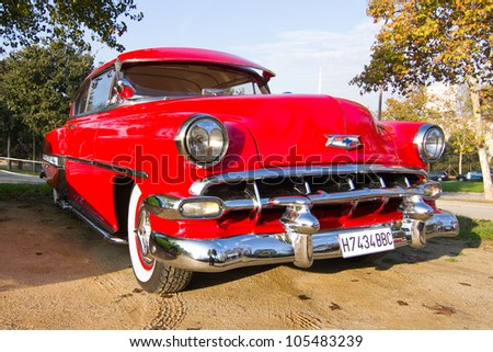 BARCELONA - NOVEMBER 12: A 1954 red Chevrolet Bel Air on display at a classic car show during Monster Jam Party, on November 12, 2011, in Olympic Stadium, Barcelona, Spain.