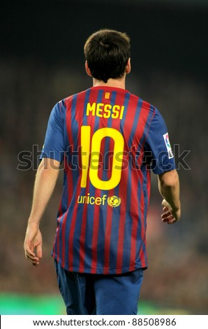 BARCELONA - OCT, 29: Back of Leo Messi of FC Barcelona walks onto the field during the Spanish league match between FC Barcelona and RCD Mallorca at the Nou Camp Stadium on October 29, 2011 in Barcelona, Spain