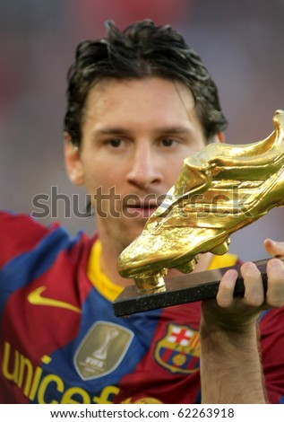 BARCELONA - OCT 3: Leo Messi of FC Barcelona with European Golden Boot award before Spanish league match between FC Barcelona and RCD Mallorca at Nou Camp Stadium in Barcelona, Spain. October 3, 2010