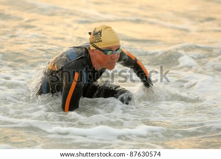 BARCELONA - OCT 16: Michelle Vesterby of Denmark finishes her swim during the Barcelona Garmin Triathlon event at Barcelona beach on October 16, 2011 in Barcelona, Spain