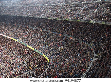 BARCELONA OCT 22 Spectators in a sold out Barcelona football stadium Camp Nou during the match between FC Barcelona and FC Sevilla on October 22 2011 in Barcelona