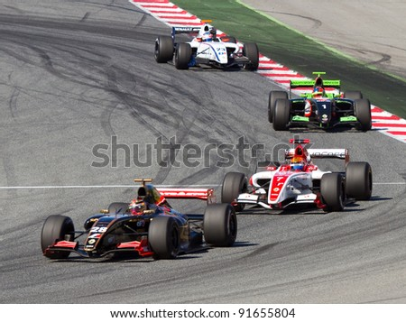 BARCELONA - OCTOBER 9: Brendon Hartley (28), Alexander Rossi (7) and Kevin Korjus (1) race at Formula Renault 3.5 World Series, on October 9, 2011, in Circuit de Catalunya, Barcelona, Spain.