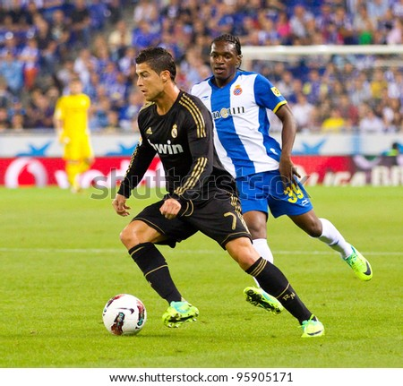 BARCELONA - OCTOBER 2: Cristiano Ronaldo (L) in action during the Spanish League match between Espanyol and Real Madrid, final score 0 - 4, on October 2, 2011 in Cornella stadium, Barcelona, Spain.