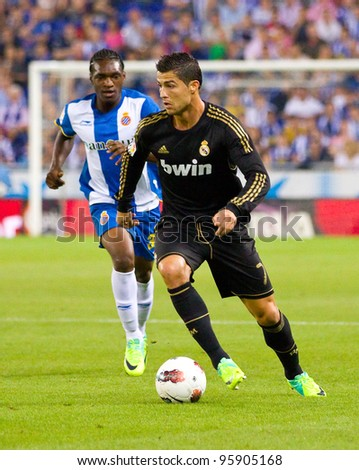BARCELONA - OCTOBER 2: Cristiano Ronaldo (R) in action during the Spanish League match between Espanyol and Real Madrid, final score 0 - 4, on October 2, 2011 in Cornella stadium, Barcelona, Spain.