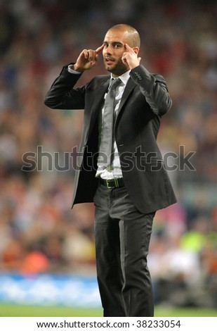 BARCELONA - OCTOBER 3: FC Barcelona coach Josep Guardiola reacts during Spanish league match between Barcelona vs UD Almeria at the New Camp Stadium on October 3, 2009 in Barcelona, Spain.