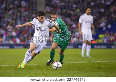 BARCELONA OCTOBER 29 James Rodriguez of RM L in action at the Copa del Rey match between UE Cornella and Real Madrid final score 1 4 on October 29 2014 in Cornella Barcelona Spain