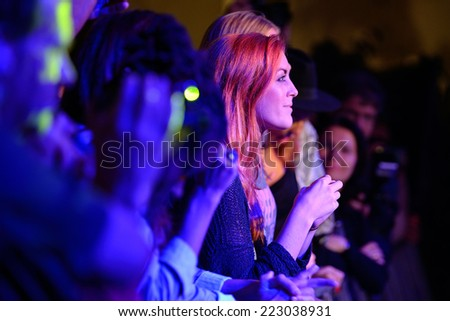 BARCELONA SEP 23 Redhead woman from the audience applauding at Barcelona Accio Musical BAM La Merce Festival on September 23 2014 in Barcelona Spain