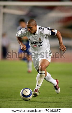BARCELONA - SEPT 18: Brazilian player Roberto Carlos of Real Madrid in action during the match between Espanyol and Real Madrid at the Olympic Stadium on September 18, 2004 in Barcelona, Spain - stock photo
