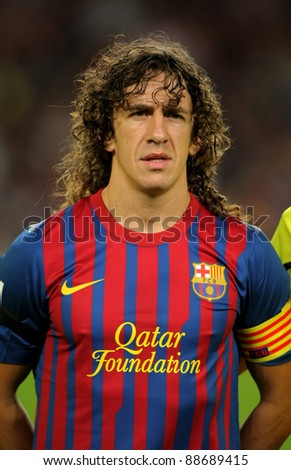 BARCELONA - SEPT, 17: Carles Puyol of FC Barcelona posing before the spanish league match against Osasuna at the Nou Camp Stadium on September 17, 2011 in Barcelona, Spain