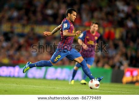 BARCELONA - SEPT 24: Daniel Alves of FC Barcelona in action during the spanish league match against Atletico Madrid at the Nou Camp Stadium on September 24, 2011 in Barcelona, Spain