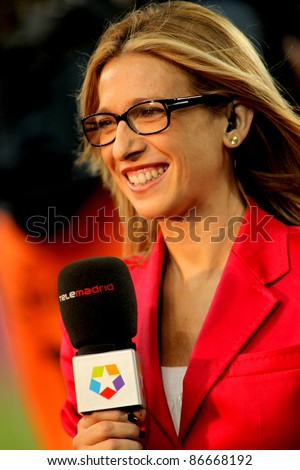 BARCELONA - SEPT 24: Lola Hernandez of Telemadrid reports before the Spanish league match against Atletico Madrid at the Nou Camp Stadium on September 24, 2011 in Barcelona, Spain