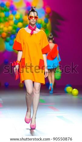 BARCELONA – SEPTEMBER 17: A model walks on the Agatha Ruiz de la Prada catwalk during the Cibeles Madrid Fashion Week runway on September 17, 2011 in Barcelona, Spain. - stock photo