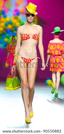 BARCELONA – SEPTEMBER 17: A model walks on the Agatha Ruiz de la Prada catwalk during the Cibeles Madrid Fashion Week runway on September 17, 2011 in Barcelona, Spain.