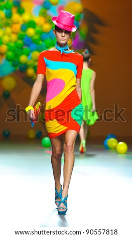 BARCELONA – SEPTEMBER 17: A model walks on the Agatha Ruiz de la Prada catwalk during the Cibeles Madrid Fashion Week runway on September 17, 2011 in Barcelona.
