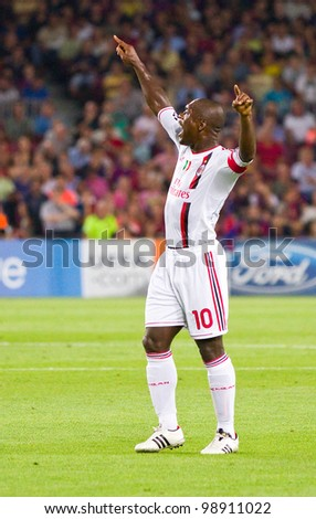 BARCELONA - SEPTEMBER 13: Clarence Seedorf of Milan in action during the Champions League match between FC Barcelona and AC Milan, 2 - 2, on September 13, 2011, in Camp Nou, Barcelona, Spain.