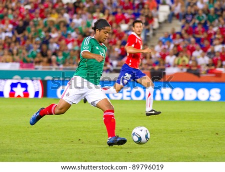 BARCELONA - SEPTEMBER 4: Giovanni Dos Santos (10) in action during the friendly match between Mexico and Chile, final score 1 - 0, on September 4, 2011, in Cornella stadium, Barcelona, Spain.