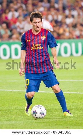 BARCELONA - SEPTEMBER 13: Leo Messi in action during the UEFA Champions League match between FC Barcelona and AC Milan, final score 2 - 2, on September 13, 2011, in Camp Nou stadium, Barcelona, Spain.