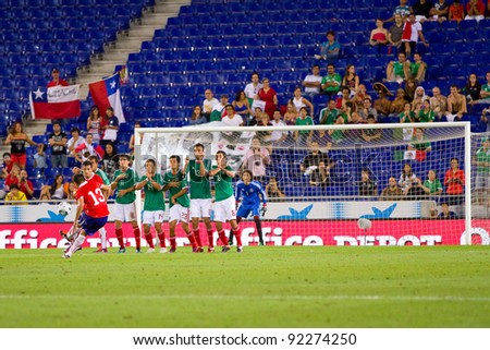 BARCELONA - SEPTEMBER 4: Unidentified player of Chile shoot a free kick during the friendly match between Mexico and Chile, final score 1 - 0, on September 4, 2011, in Cornella, Barcelona, Spain.