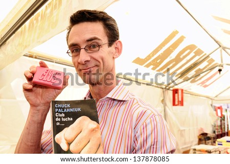 BARCELONA, SPAIN - APR 23: Chuck Palahniuk, author of the  novel Fight Club, which also was made into a feature film, signs books in the streets of Barcelona on April 23, 2012 in Barcelona, Spain.