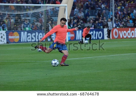 BARCELONA, SPAIN - APR 28: Xavi Hernandez, FC Barcelona player, trains before the Champions League match against Chelsea of  at the Camp Nou Stadium  on April 28, 2009 in Barcelona, Spain.