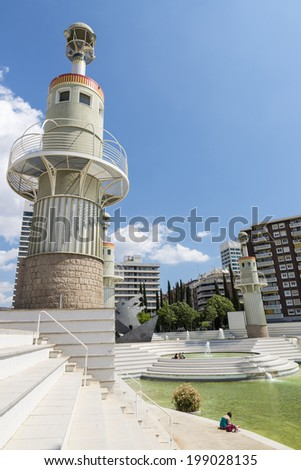 Barcelona, Spain - 23 April, 2014: Spain Industrial Park is located in the Sants-Montjuic in Barcelona, Catalonia, Spain, near the railway station of Sants. There are people sunbathing or reading