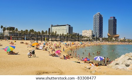 BARCELONA, SPAIN - AUGUST 16: Barceloneta Beach with Hotel Arts in the background on August 16, 2011 in Barcelona, Spain. Hotel Arts is a 44-story, 483 room luxury hotel on the seafront of the city