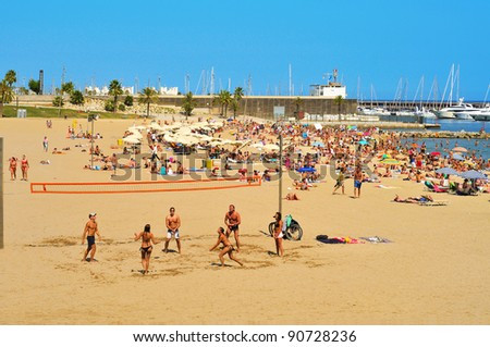 BARCELONA, SPAIN - AUGUST 8: Barceloneta-Somorrostro Beach on August 8, 2011 in Barcelona, Spain. This beach, 522 meters long, hosts about 400,000 visitors during the summer season