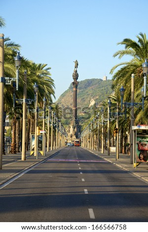 BARCELONA, SPAIN - AUGUST 21. Early morning on the Boulevard Passeig de Colom in Barcelona on August 21, 2013. The boulevard leads along the harbor to Columbus monument
